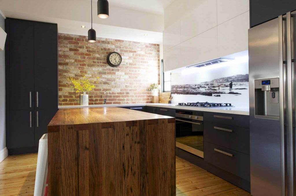 Timber and exposed brick kitchen features