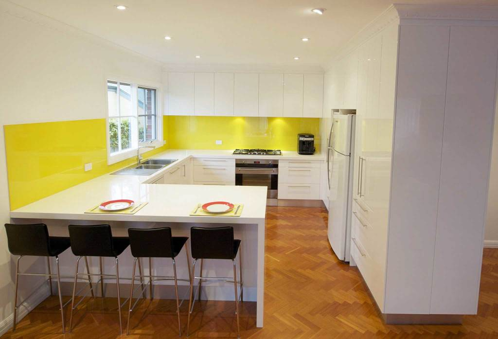Camberwell kitchen with yellow glass splashback