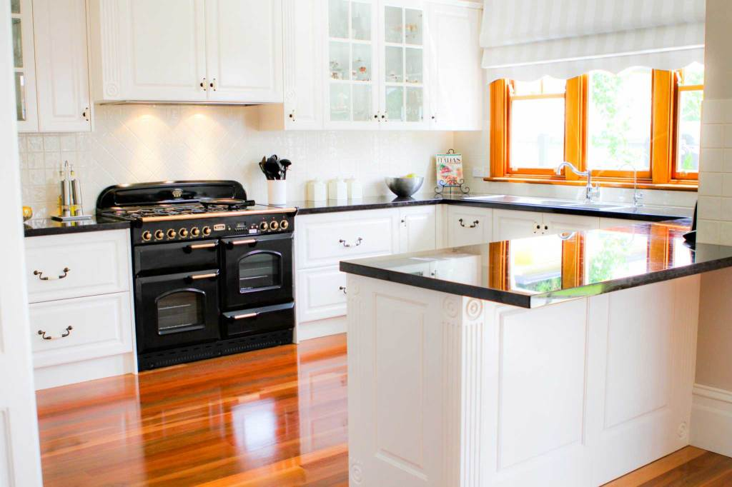 Image of white kitchen with contrasting black features in Coburg.