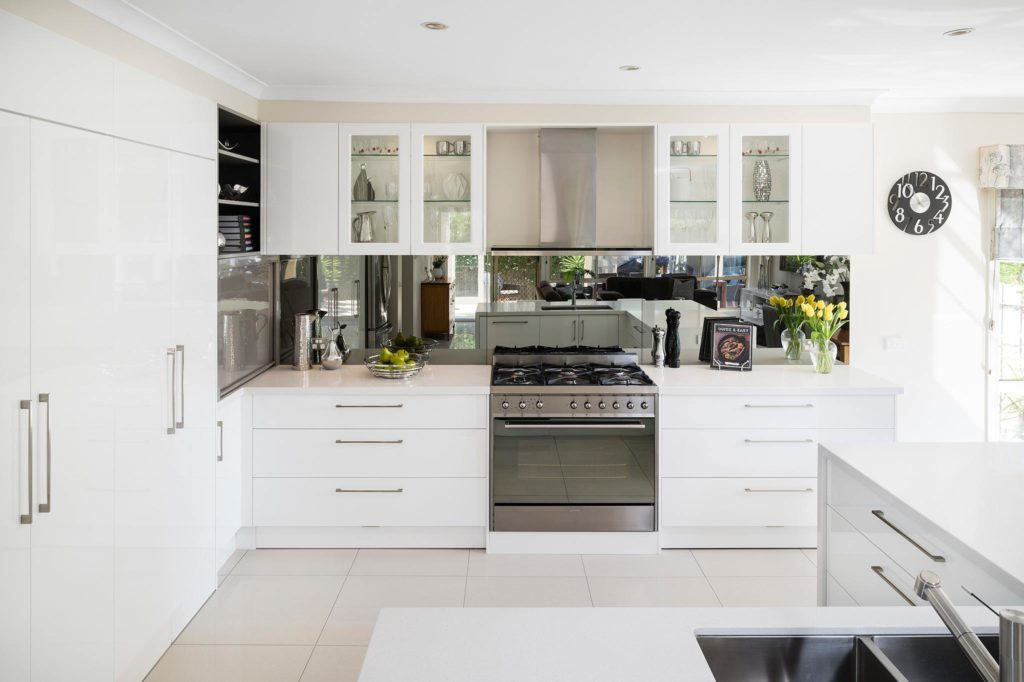 A gorgeous white kitchen that combines form and function on mirror tile backsplash ideas, beautiful classic kitchen white, mirror tile back splash for kitchen,
