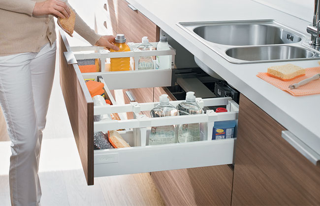 An innovative Blum drawer that runs under and around the sink.